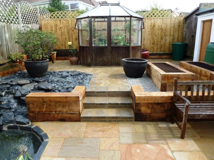 Full rear garden makeover including ornamental pond, glasshouse, raised beds, paving