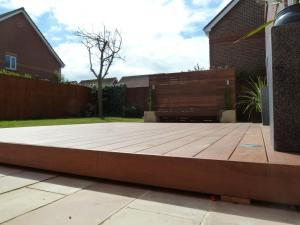Garden makeover with paving, floating Ipe hardwood deck, vertical screen and planters