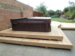 Garapa hardwood deck surrounding hot tub