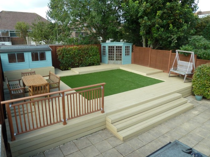 Composite deck with handrail