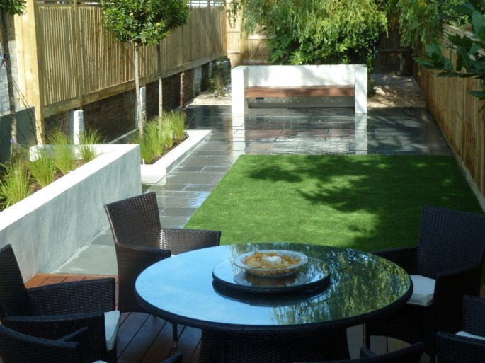 Rattan garden furniture to compliment the build.