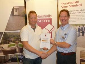 Jon receiving a Marshalls Register award