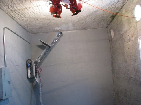 Remote climbing platform from ICM applying fixative inside hot cell testbed