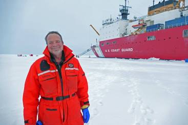 Dr. Kadko at the North Pole with the US Healy on the background