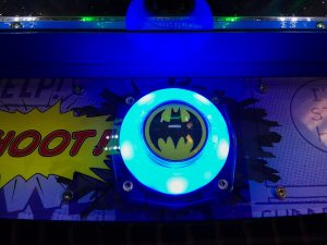 Close up of Batman play button on the DC comics coin pusher