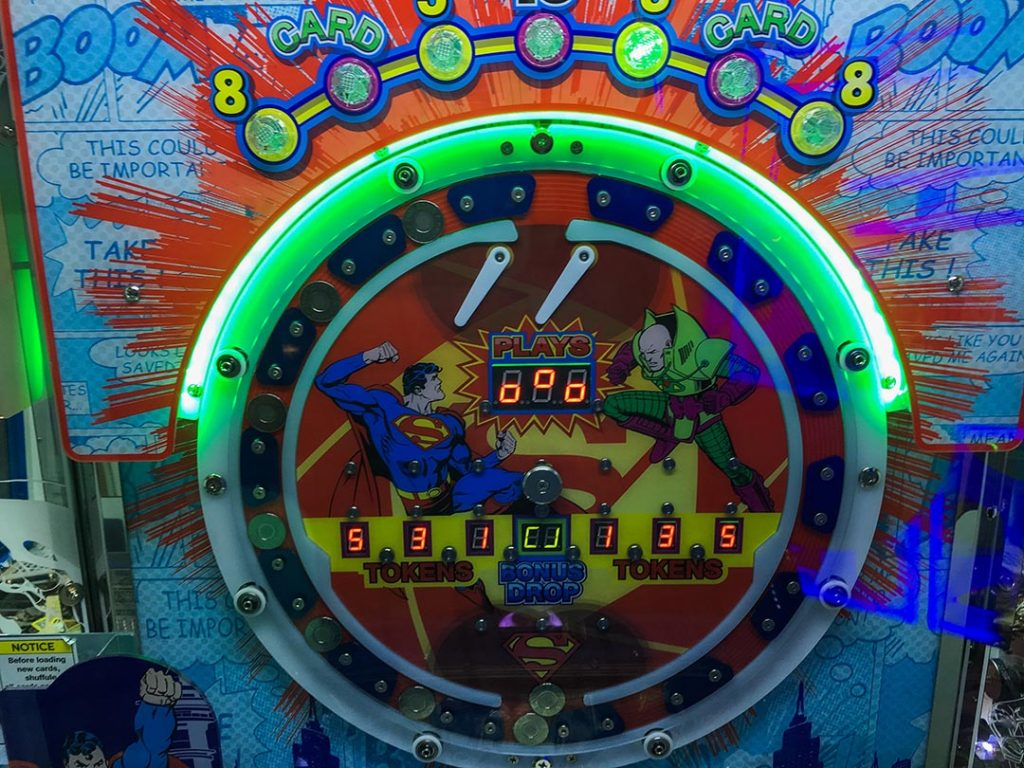 Close up of Superman themed coin play section of the super hero arcade game