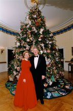 1995, President Bill Clinton and First Lady Hilary Rodham Clinton standing in front of the White House Christmas tree.