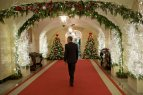 President Barrack Obama admiring the White House interior holiday decorations in 2008.