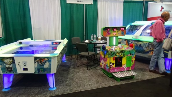 WIK USA showing off their newest air hockey tables (which include an innovative puck dispenser to reload pucks in case one is lost)