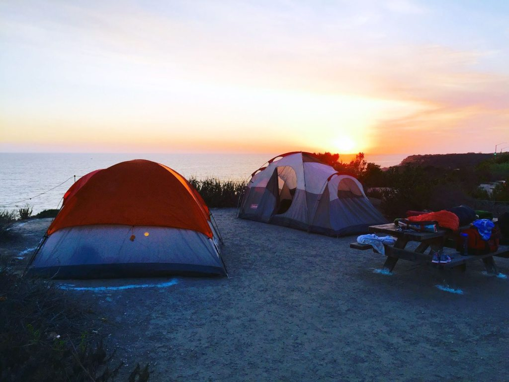 Guided group tour tent camping set up overlooking the Pacific Ocean with Occidental College | arc Adventure