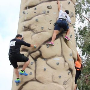Group competition on the rock wall during a team building adventure race at Hansen Dam | arc Adventure