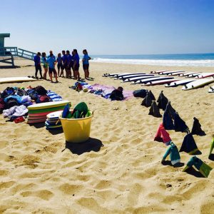 Surf lessons in Santa Monica, standing on the beach.
