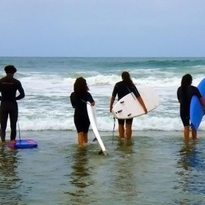 Surf lessons in Santa Barbara, about to enter the water.