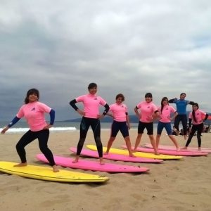 Surf lessons in La Jolla, posing on the beach.