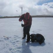 Probing to determine snow depth. (Photo: E. Watson)