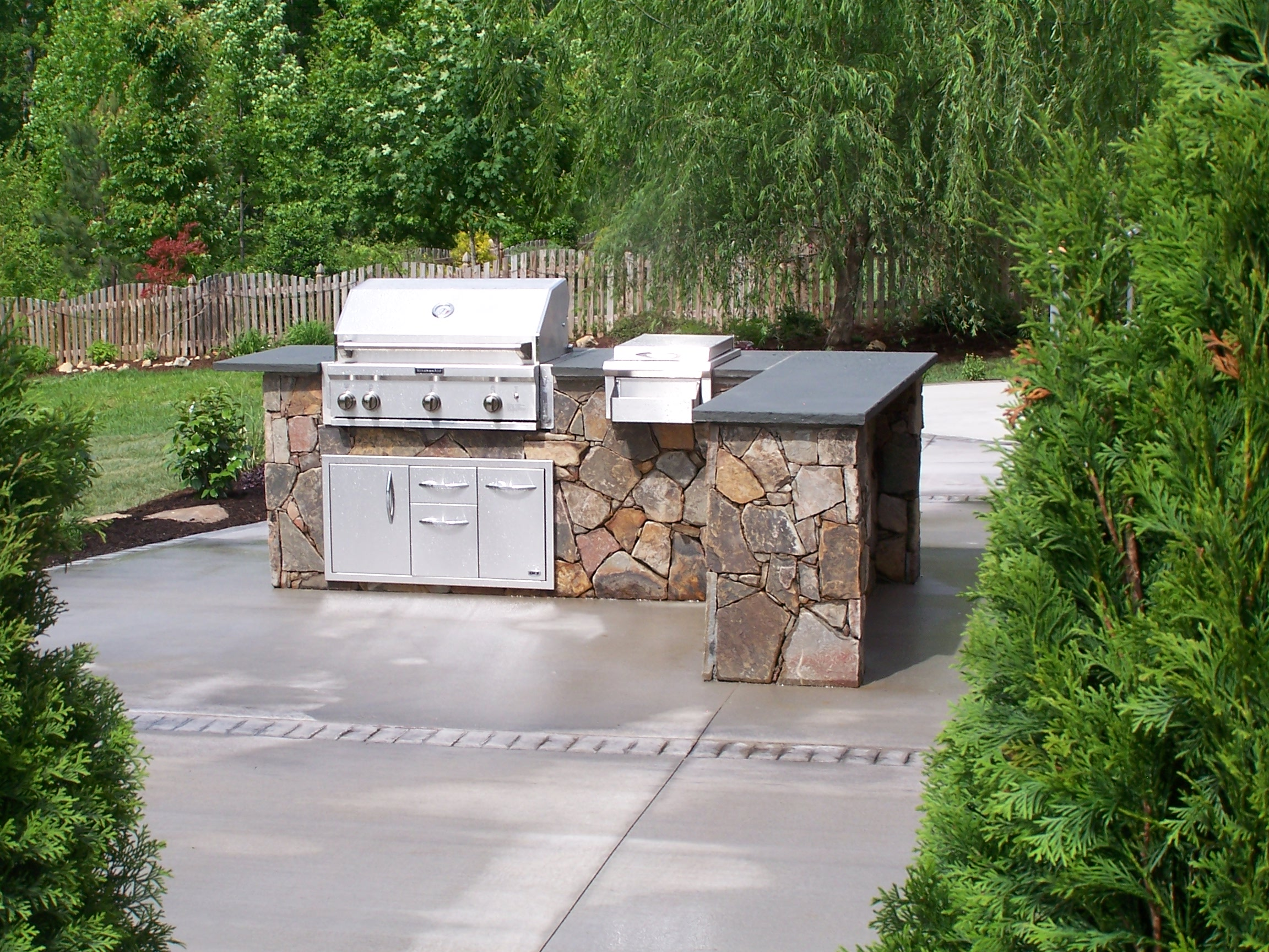 outdoor kitchen design  We build decks sunrooms screened porches outdoor living rooms and