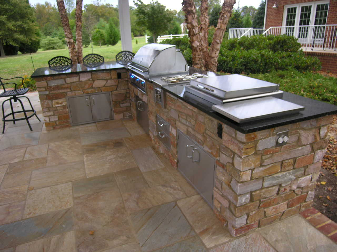 Outdoor kitchens  this aint my dads backyard grill  We build decks sunrooms screened