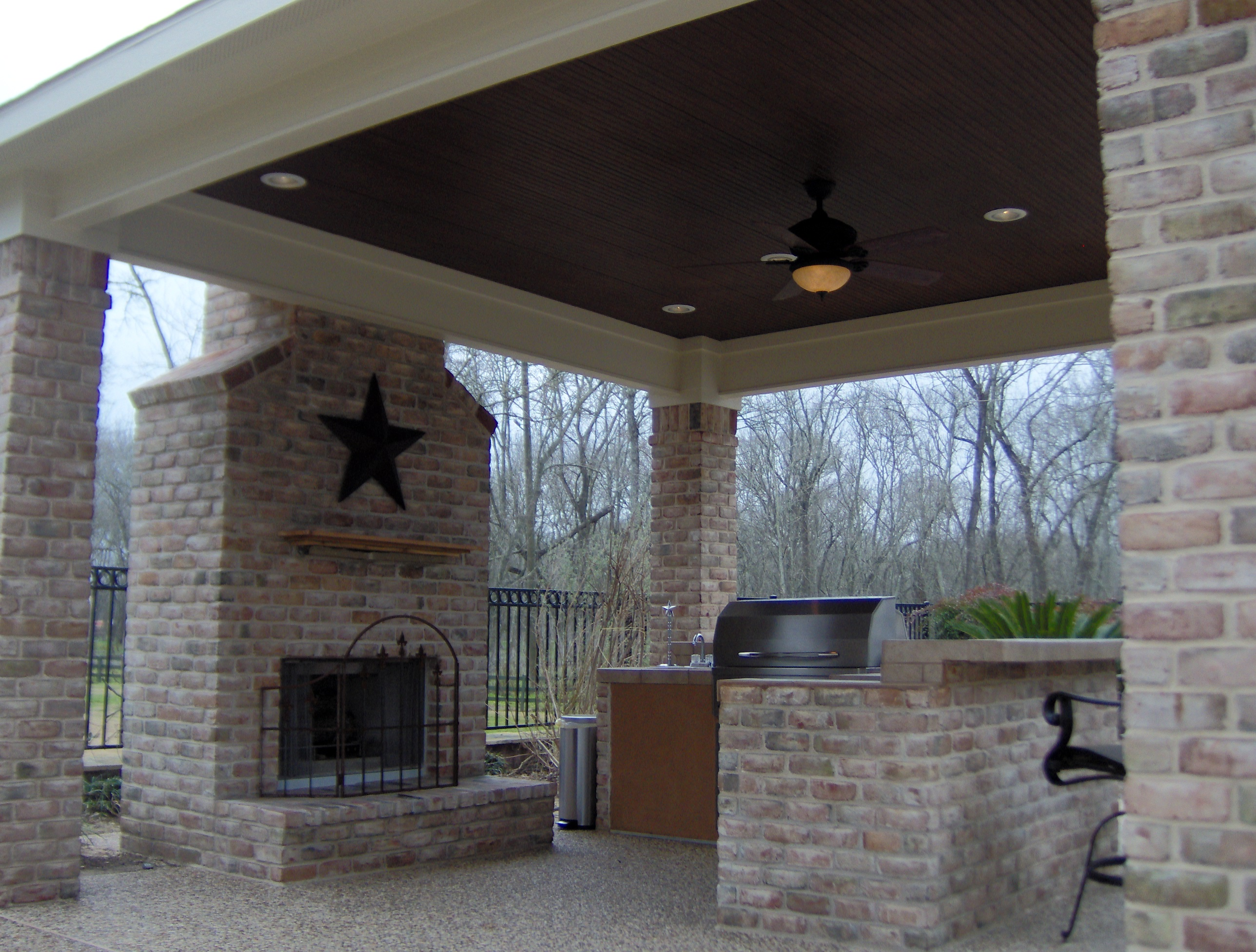 outdoor kitchen with fireplace stainless steel shelves for open porch archadeck of charlotte