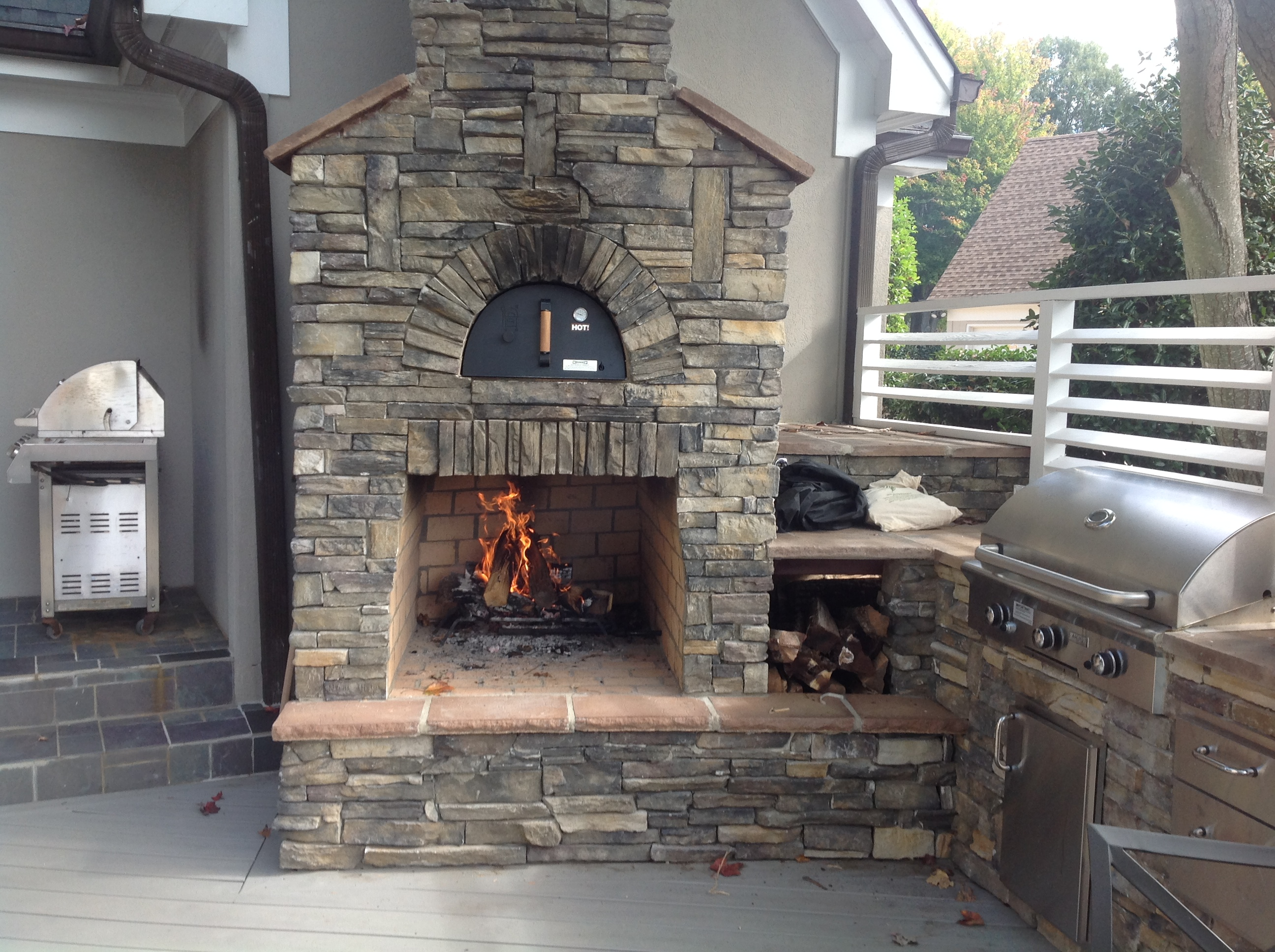 outdoor kitchen with fireplace cabinets woburn ma archadeck of charlotte voted best in design award by houzz