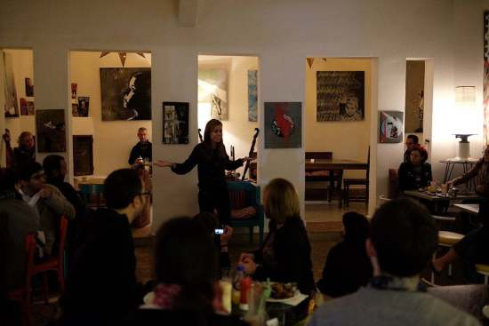 Malika Ben Allal engaging and captivating audiences storytelling at Cafe Clock in Marrakech.