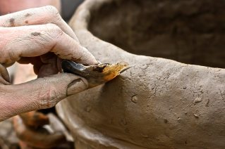 Scoring a pot with Flint, at UCD Centre for Experimental Archaeology