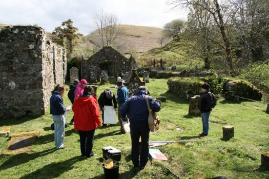 Volunteers conducting graveyard survey