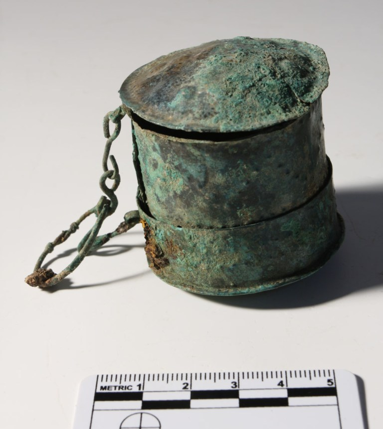 The enigmatic 'workbox', found placed on the chest of a young woman.