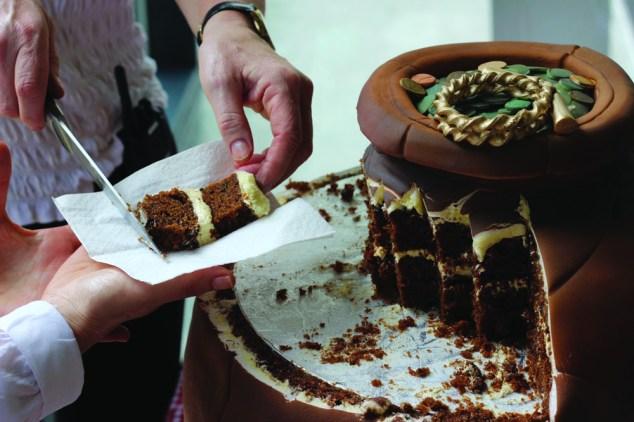 Somerset Museum Roman hoard cake - the cutting - credit peboryon_opt