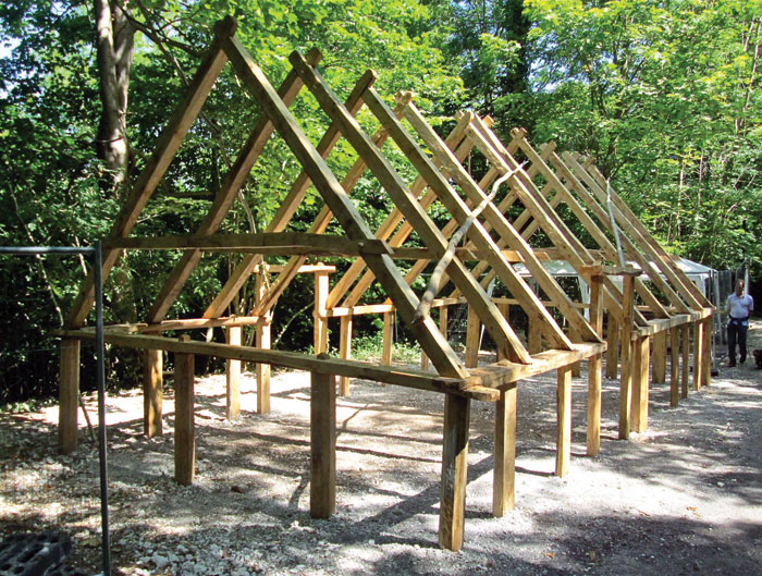This reconstruction of a 10th-century house at the Weald and Downland Museum, Singleton, West Sussex, is based on timbers recovered from waterlogged deposits in London. The use of removal pegs to hold the structure together suggests these buildings were designed to be erected and disassembled for  ease of movement and transport: a sophisticated design.