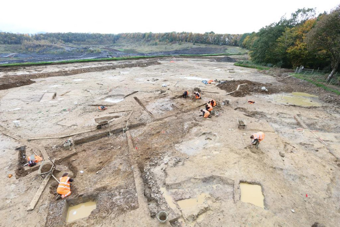 The excavation site with archaeologists at work