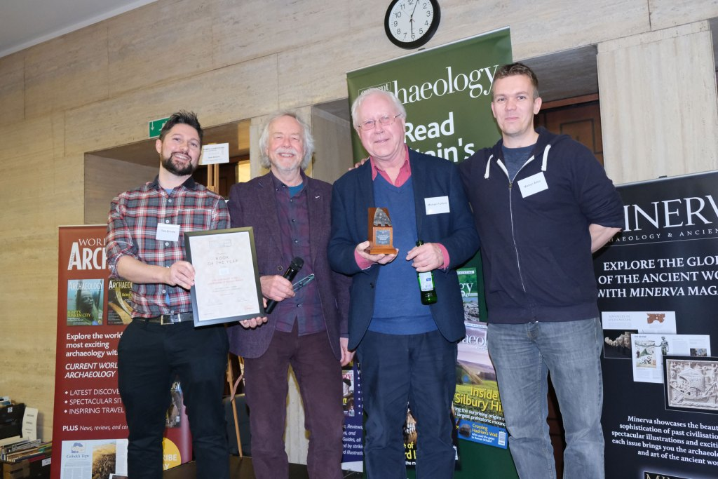 Julian Richards (second from left) presents some of the authors of Life and death in the countryside of Roman Britain with the award for Book of the Year 2020 at the Current Archaeology Awards. (l-r: Tom Brindle, Julian Richards, Michael Fulford, Martyn Allen)
