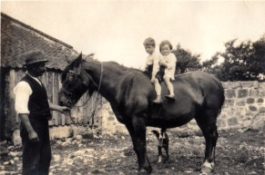 Mary and her brother on horseback