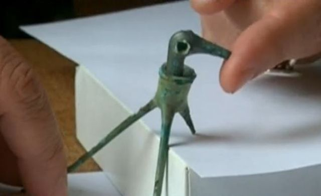 Prof. Nikolay Ovcharov demonstrates the motion range of the head of the 3,500-year-old toy stork figure, which also might have had a religious meaning. It was found near Yagnevo in Southern Bulgaria. Photo: TV grab from BNT