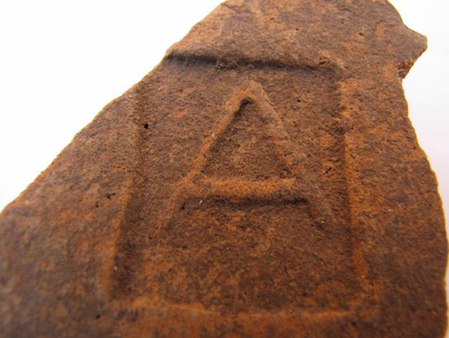 """More than two dozen of roof tiles with the image of the letter """"A"""" (alpha) apparently dedicated to god Apollo have been discovered during the excavations of a suburban estate from the 5th-3rd century BC near the Ancient Greek colony Apollonia Pontica, today's Bulgarian resort of Sozopol. Photo: Chernomorie BG"""