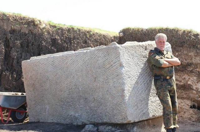Hristo Hristov, Director of the Elhovo Museum of Ethnography and Archaeology, posing with the unearthed 6-ton Thracian sarcophagus. Photo: ElhovoNews