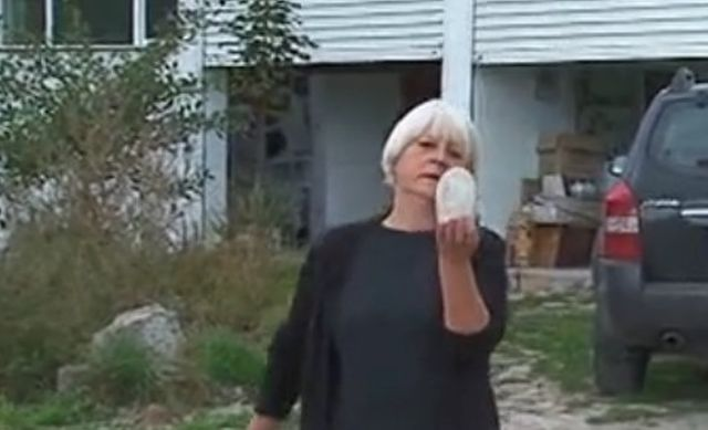 Zlatka Churtova shows the alleged phallus that was part of an ancient deity statue at the suspected Thracian shrine near Bulgaria's Orehovo. Photo: TV grab from bTV
