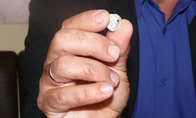 Archaeologist Georgi Maystorski from the Shumen Regional Museum of History shows the newly found silver coin of Wallachian ruler Mircea the Elder which probably dates back to the 1380s-1390s. Photo: Top Novini Shumen