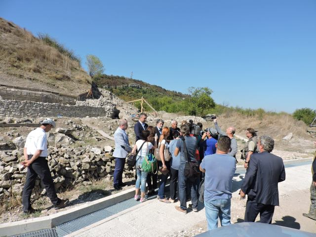 Lead archaeologist Vasil Nikolov, Culture Minister Vezhdi Rashidov, and other officials talking to reporters at the Salt Pit town. Photo: Provadiya - Solnitsata Prehistoric Settlement Facebook Page