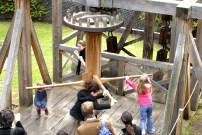 Children operating Roman Water Wheel Event type: school Event Title: Roman Water Wheel Age: KS2