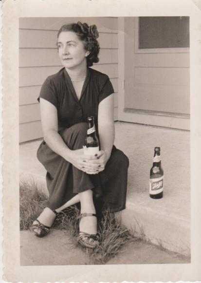 Whoever took this photo of my great aunt would like you to know, via a careful note on the back, that the second beer is theirs.