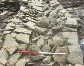 Rebuilt south west wall of structure 12