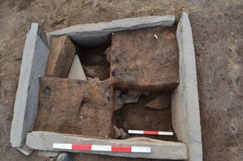 Figure 1: A multi-layered hearth from the NE side of structure 14, Ness of Brodgar (Nick Card)