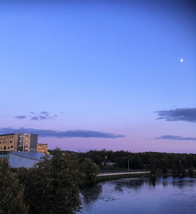 River running through the campus at dusk