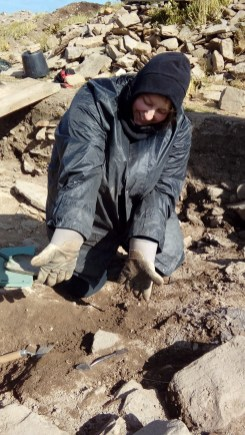 A happy Catherine moments after discovering the bronze ring. You can see it next to the tip of her 'leaf' trowel