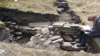 Sam working in Trench 4 with possible Norse wall in the background