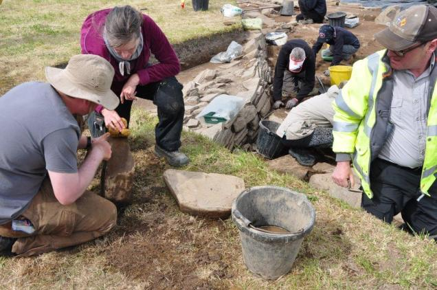 Examining finds at the Ness of Brodgar