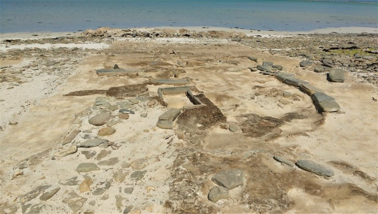 The Cata Sand site showing the wall of the house on teh right and one of the hearths in the centre