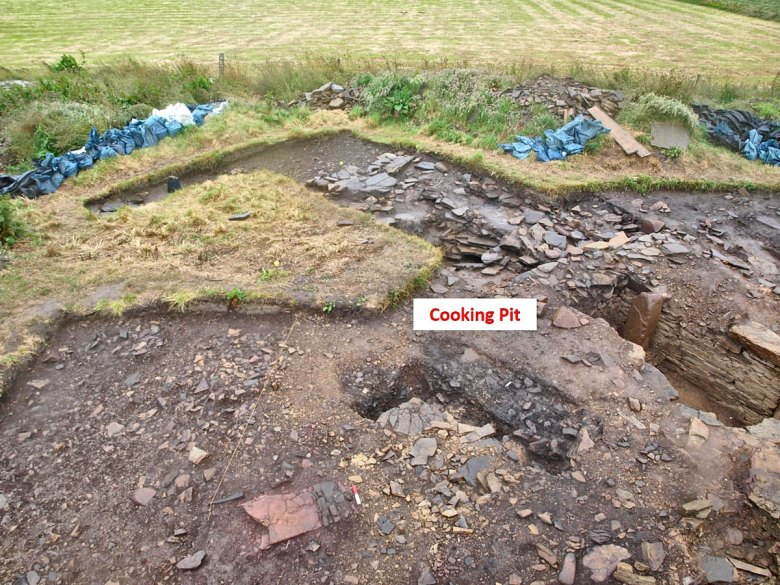 The half-sectioned 'cooking-pit' cut into the remains of The Cairns broch wallhead.
