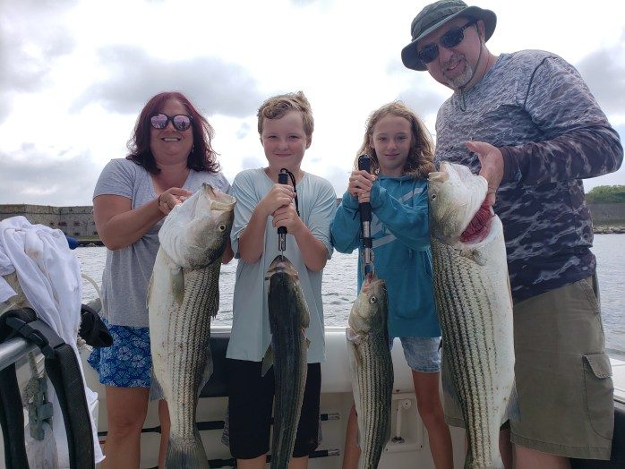 Family holding fish on Arch Angel Charter