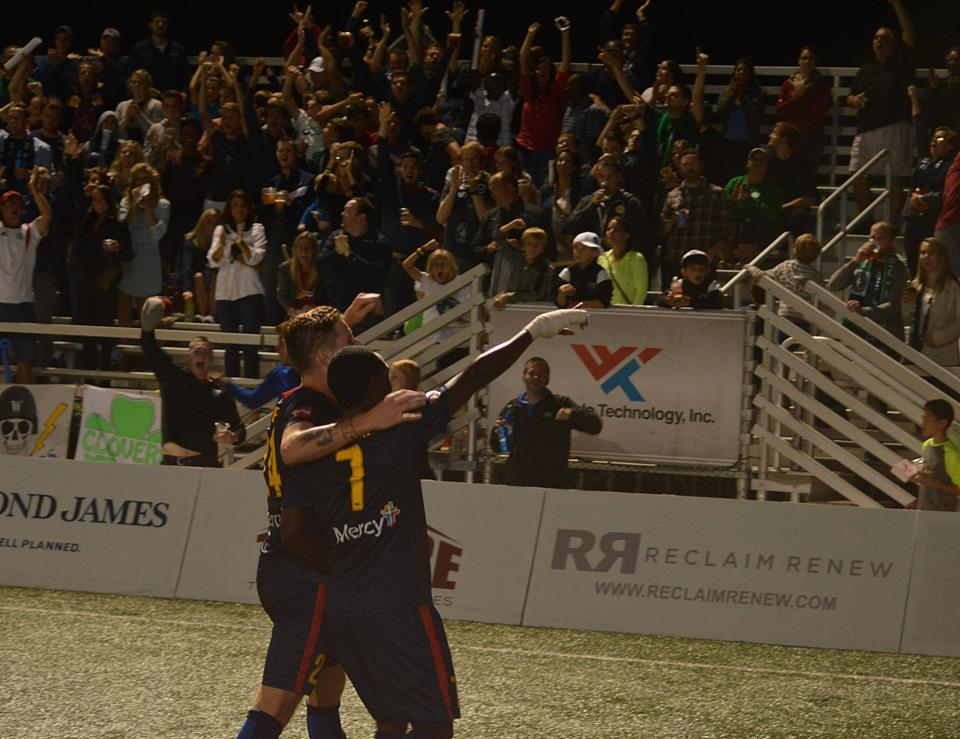 Jamiel Hardware celebrates with Peter Kelly after scoring against Louisville